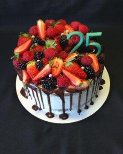 """8"""" 2 later, 1/2 Choco/vanilla kake filled w/ vanilla bean cream, covered in vanilla bean whip, topped w/ dark Choco drip, fresh berries, sprinkles & chocolate numbers."""